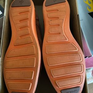 Cole Haan loafers with orange soles.